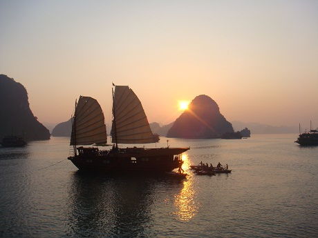 Floating boat in Ha Long Bay at sunset