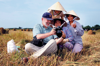 Foreign tourists with Vietnamese in the field
